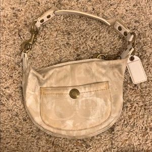 9 inch cream colored monogrammed COACH bag